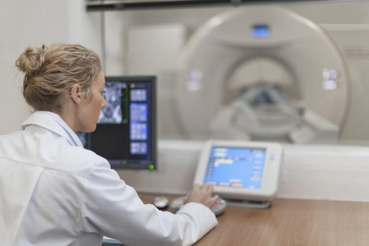 An imaging technologist conducting a body scan.