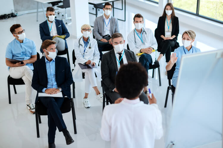 A healthcare leader holding a staff meeting.