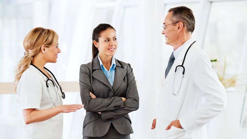 Three medical professionals having a discussion